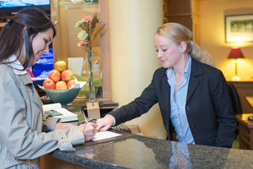 Hotel desk clerk image with customer